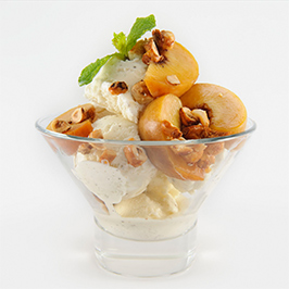 Maker's Mark® Ice Cream topped with Poached Peaches and Hazlenut Crunch
